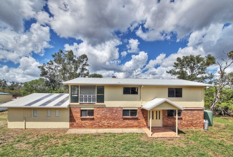 Enjoy Acreage Living Near Sunnybank Hills